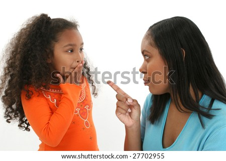 Adorable five year old African American Girl and mother having an argument - stock photo