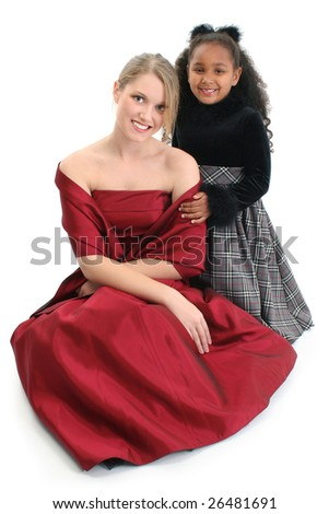 Adorable five year old African American Girl and Sixteen yer old Caucasian girl in formals.