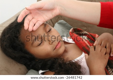 Adorable five year old African American Girl in bed sick.