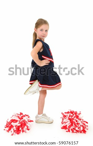 Adorable five year old american girl cheerleader over white in uniform with pompoms