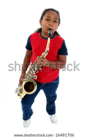 Adorable five year old black girl playing the saxophone over white.