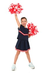 Adorable five year old french american girl cheerleader over white with pompoms.