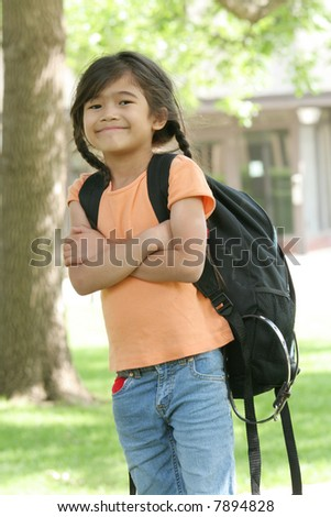 Adorable five year old girl ready for first day of school