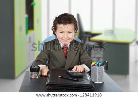 Adorable future businessman in the office