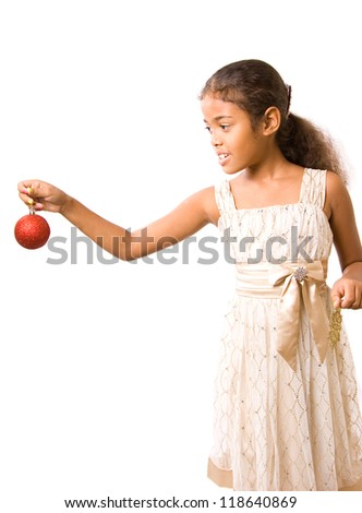 adorable girl decorates christmas tree ornaments (isolated)