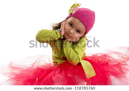 Adorable girl in tutu and hat with butterfly over white back