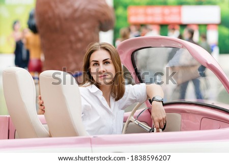 Adorable girl In Vintage Convertible. Portrait Of Woman Enjoying Road Trip In Open Top Classic Car. stock photo