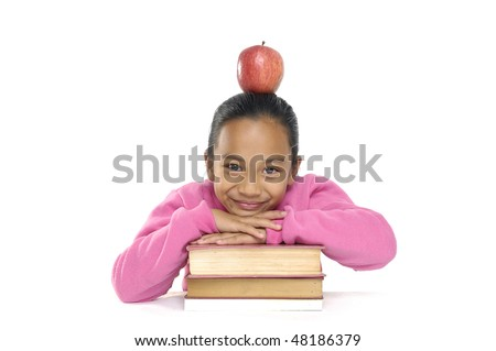 Adorable girl studying with books and apple in the head - stock photo