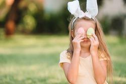 Adorable girl wearing bunny ears on Easter holliday