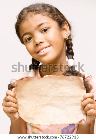 adorable girl with old paper in her hands