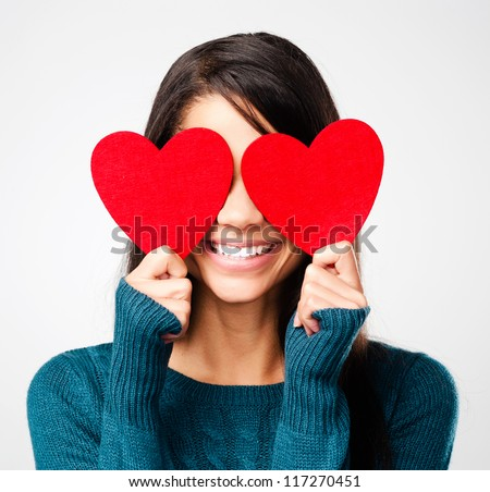 adorable girl with valentines day heart showing love fun affection portrait on grey background