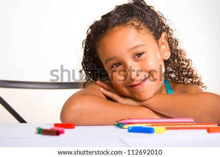 adorable girl writing at her desk