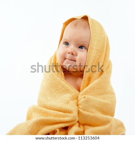 Adorable happy baby in yellow towel
