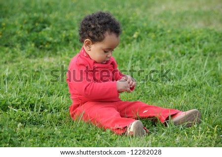 adorable happy baby on the green grass
