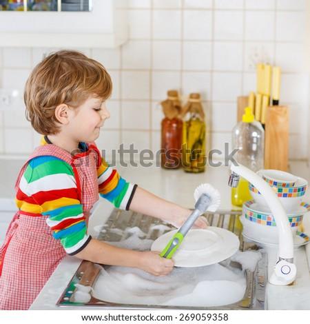 Boy Washing Dishes Kid Boy Washing Dishes in