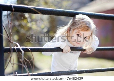 Adorable happy toddler girl smiling outdoors
