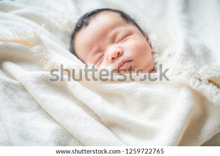 Adorable infant kid sleeping on blanket, One month baby