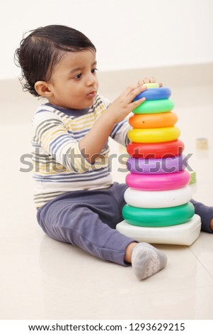 Adorable infant stacking colorful ring toys