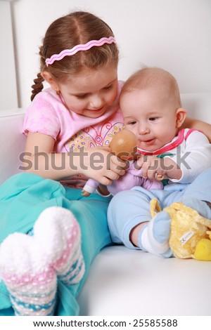 Adorable kids playing playing together