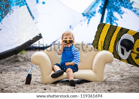 Adorable kiteboarder boy in the chair