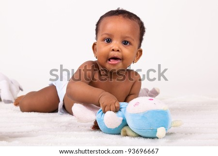 Adorable little african american baby girl  lying down