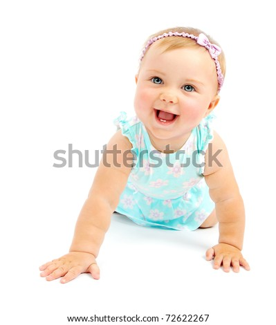 Adorable little baby girl laughing, creeping & playing in the studio, isolated on white background