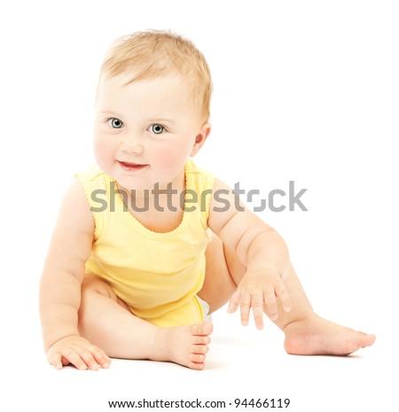 Adorable little baby girl smiling, sitting on the floor, studio shot, isolated on white background, lovely baby portrait
