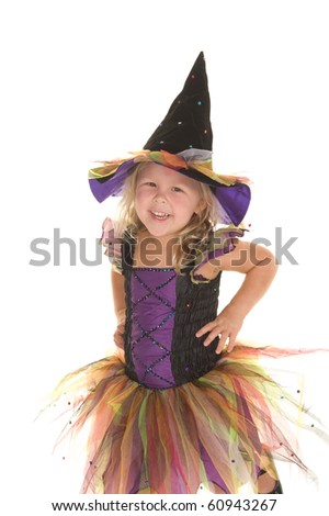 Adorable little blond girl smiling dressed as a beautiful witch for Halloween