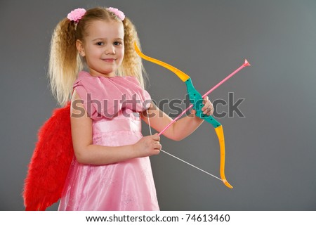 Adorable little blond with wings and bow