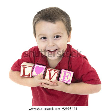 "Adorable little boy holding blocks that spell ""Love"""