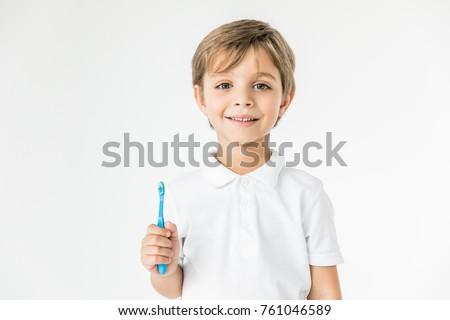 adorable little boy holding...