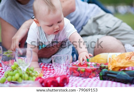 Adorable little boy on his first picnic - stock photo
