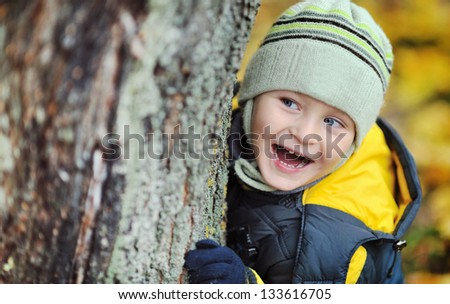Adorable little boy playing outdoors