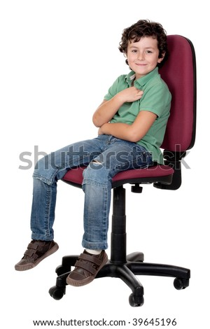 Adorable little boy sitting on big chair isolated on white.