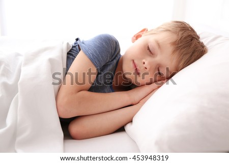 Stock Photo Adorable little boy sleeping in bed