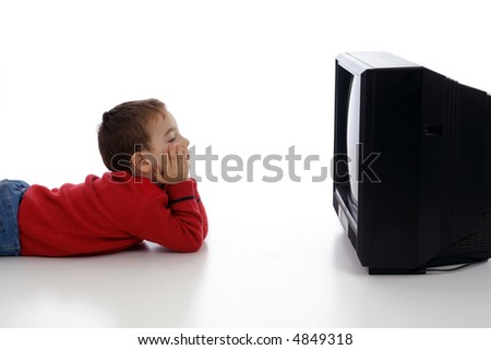 Adorable little boy watching tv