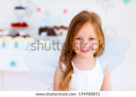 Adorable little fairy girl on a birthday party