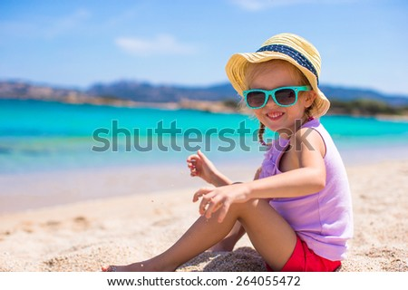 Adorable little girl at tropical beach during vacation #264055472
