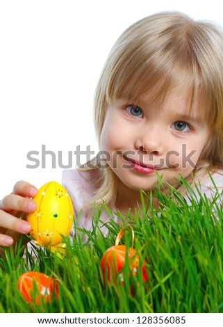 Adorable little girl collecting Easter eggs in her basket. Vertical view. Isolated white backround