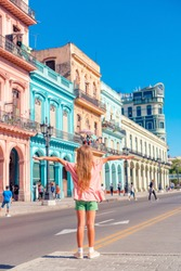 Adorable little girl in popular area in Old Havana, Cuba. Back view of beautiful kid outdoors on a street at Havana