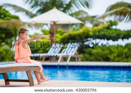 Adorable little girl making selfie near a swimming pool #420003796