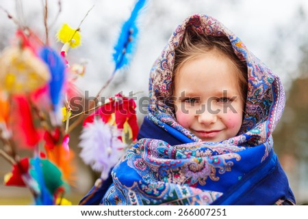 Adorable little girl outdoors dressed for Easter traditional celebration in Finland - stock photo