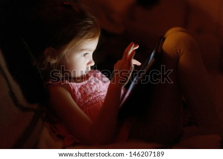 adorable little girl playing on ...