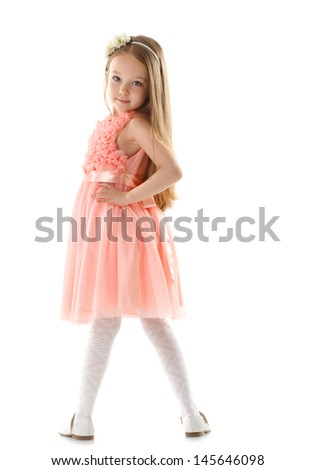Adorable little girl posing looking at camera