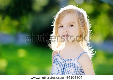 Adorable little girl smiling outdoors