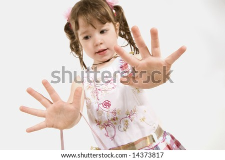 Adorable little girl stretching out hands isolated on white