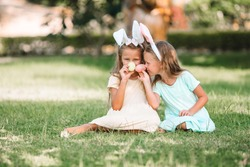 Adorable little girls wearing bunny ears on Easter holliday
