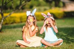 Adorable little girls wearing bunny ears on Easter holliday