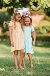 Adorable little girls wearing bunny ears on Easter holliday. Easter time