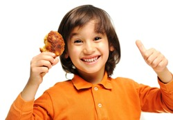 Adorable little kid holding chicken wings and show good sign